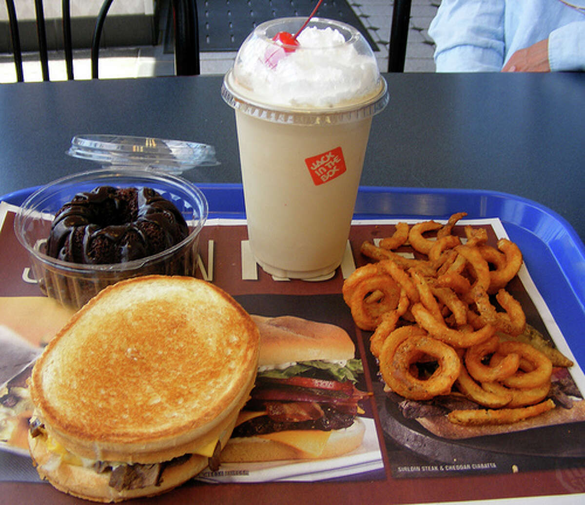 Eating fast food for lunch: Most office-folk go out for an unhealthy lunch once in a while - some more than others, but even the occasional indulgence has its negative effects. A portion of fast food usually has around double the calories to another similar food of the same size, and they have a lot of oxidized fat, which increases the risk of heart disease. (Photo: Newbirth35, Flickr) Source: Business Insider