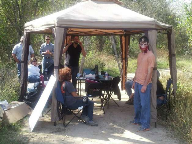 The production headquarters on the set of the ÒThe Last Meal,Ó a zombie-themed short that was filmed in Von Ormy. On the phone is Production Manager Michael Esquivel. Zombie in front is Randall Hilger, an actor and student at Palo Alto College. Photo: Courtesy Photo