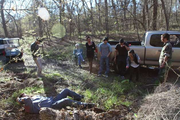 On the set of the ÒThe Last Meal,Ó a zombie-themed short that was filmed in Von Ormy. From left: Emmanuel Delfin, director/executive producer; actor Charlie Brown; actress Ana Leal; effects supervisor Chris Calderon; producer Brian Ramirez; producer Mireya Robles; actor Randall Hilger; on the ground: actor Miguel Portillo. Photo: Courtesy Photo