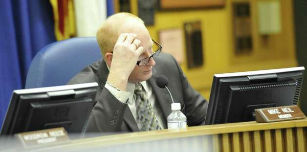 Beaumont Independent School Board Trustee Mike Neil, has questions for school attorney, Melody Chappell, who was addressing them and giving an update.     Dave Ryan/The Enterprise
