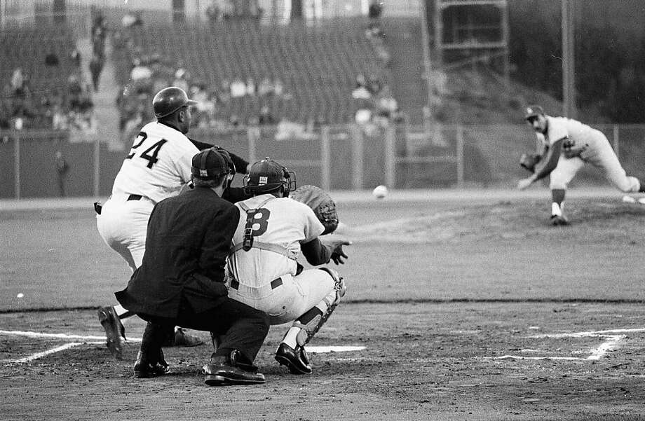 Two greats: Sandy Koufax of the Los Angeles Dodgers pitches to Willie Mays during a game on May 5, 1966 in San Francisco. Photo: Herb Scharfman, Getty Images