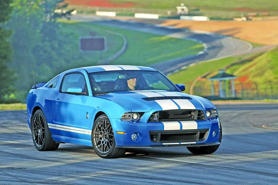 The 2013 Ford Shelby Mustang GT500 is the last Mustang that Carroll  Shelby helped design before his passing. If there's such a thing as a  vehicle being over-powered, this is it. Photo: Courtesy Ford