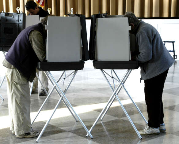 Voters cast their ballots on election day, Nov. 4, 2008 at Bryan Memorial Town Hall in Washington Photo: Norm Cummings