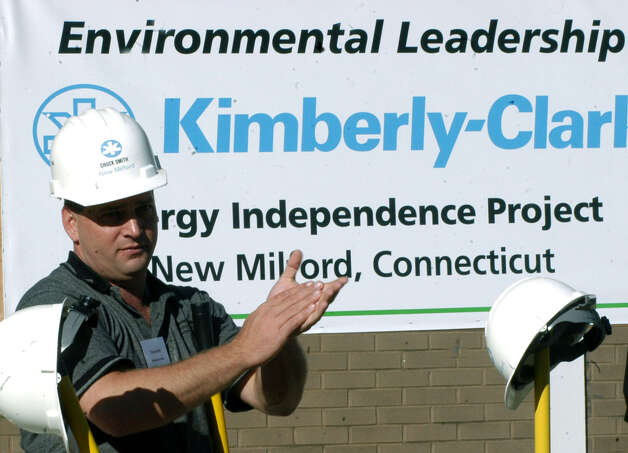 Chuck Smith, manager for the energy independence project at Kimberly-Clark in New Milford, applauds everyone's efforts. Oct. 16, 2007 during the project groundbreaking. Photo: Norm Cummings