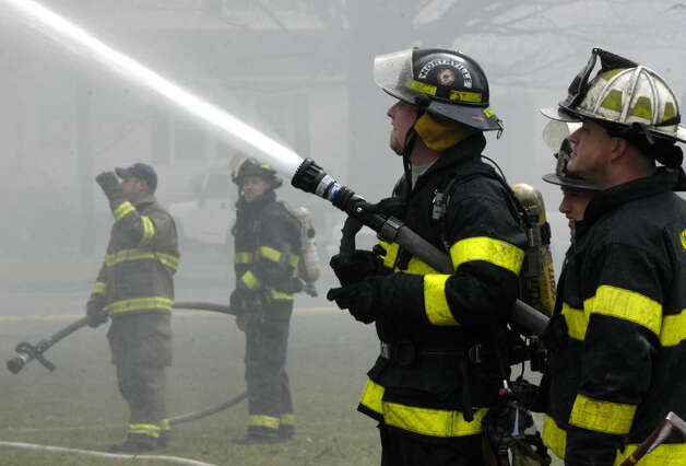 An unoccupied house at 33 Park Lane along Route 202 in New Milford appeared gutted Monday in late morning by a fire of undetermined cause. Firefighters from New Milford's Water Witch Hose Co. No. 2, Gaylordsville and Northville were among those battling the blaze. March 30, 2009. Photo: Norm Cummings