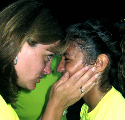 Greater New Milford Chamber of Commerce Executive Director Denise DelMastro has a heart to heart with recent New Milford High School graduate Joanna Hernandez, moments after Joanna had been awarded the Chamber's annual $1,000 college scholarship. The presentation came during a ceremony on the stage shortly before the July 24-25, 2009 Village Fair Days came to a close. Photo: Norm Cummings