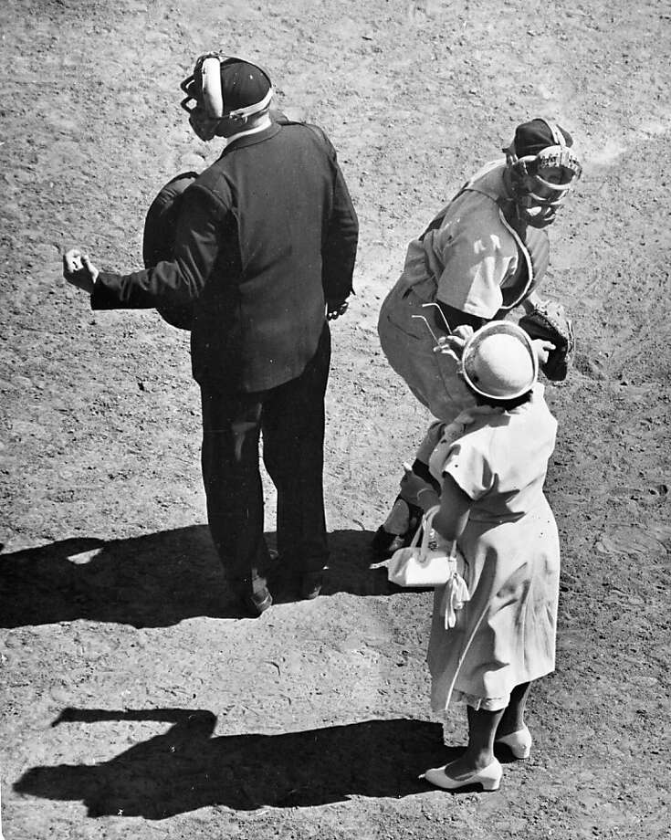 An irate Sadie Case of Emeryville offers her glasses to the umpire during a Mother's Day game at Seals Stadium in 1953. You tell 'em, Sadie! Photo: Bob Campbell, SFC