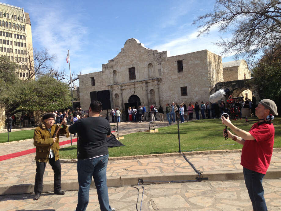 Chet Garner, host of The Daytripper travel show on PBS, shoots a scene in front of the Alamo. Garner and the crew are in town on letter weekend by coincidence.