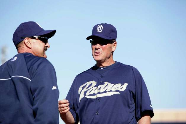 Richard Dauer talks with fellow Padres coach, Tom Tornincasa while waiting for infielders to take ground balls during spring training on Monday, Feb. 18, 2013 in Peoria, AZ.  Photo by Jason Wise Photo: Jason Wise