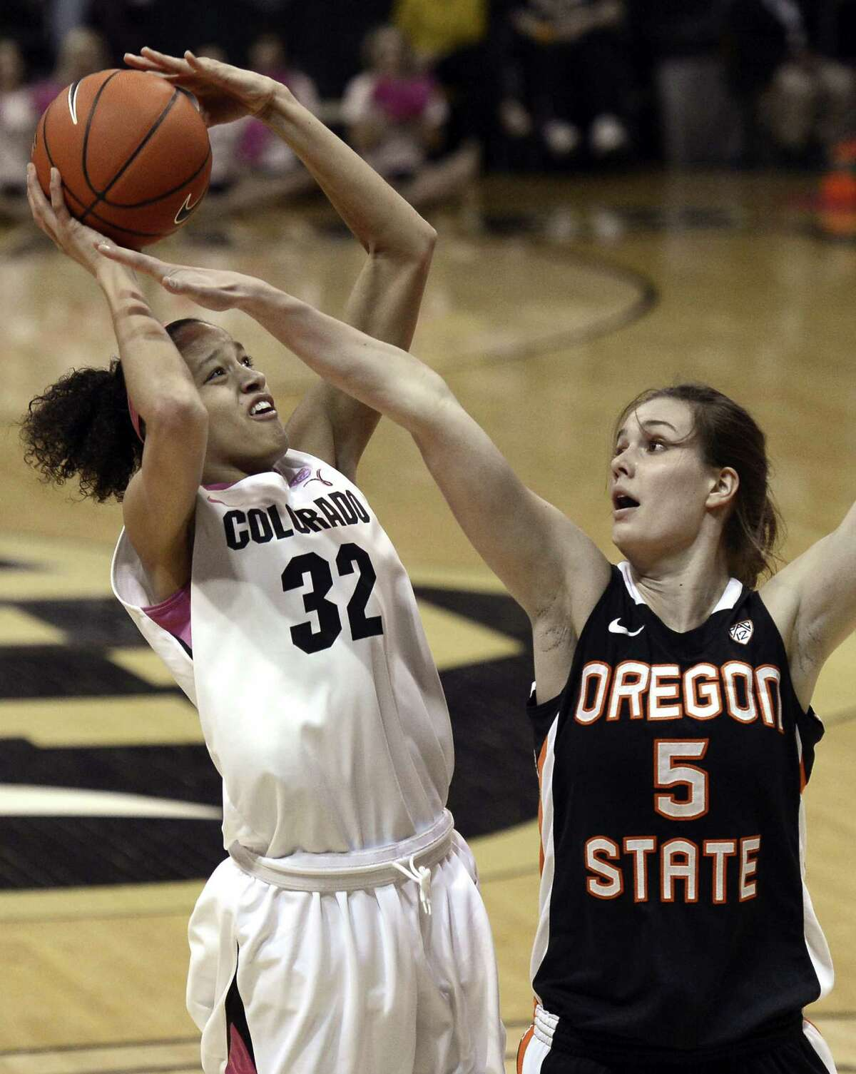 Colorado's Arielle Roberson takes a shot over Oregon State's Samantha Siegner during an NCAA college basketball game Friday, Feb. 8, 2013 in Boulder, Colo. (AP Photo/Daily Camera, Jeremy Papasso)