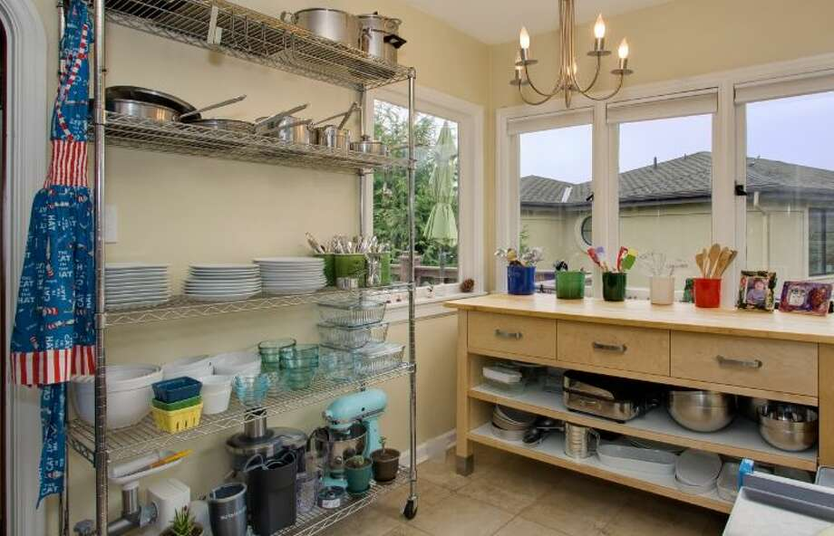Kitchen of 327 Lake Washington Boulevard. The 2,560-square-foot  brick house, built in 1928, has four bedrooms and 2.25 bathrooms -- including a master suite with vaulted ceilings and a wall of windows -- a family room, a rec room, exposed wood moldings and doors, a deck, a patio and an outdoor hot tub on a 5,362-square-foot lot. It's listed for $995,000. Photo: Courtesy Kathryn Hinds/Windermere Real Estate