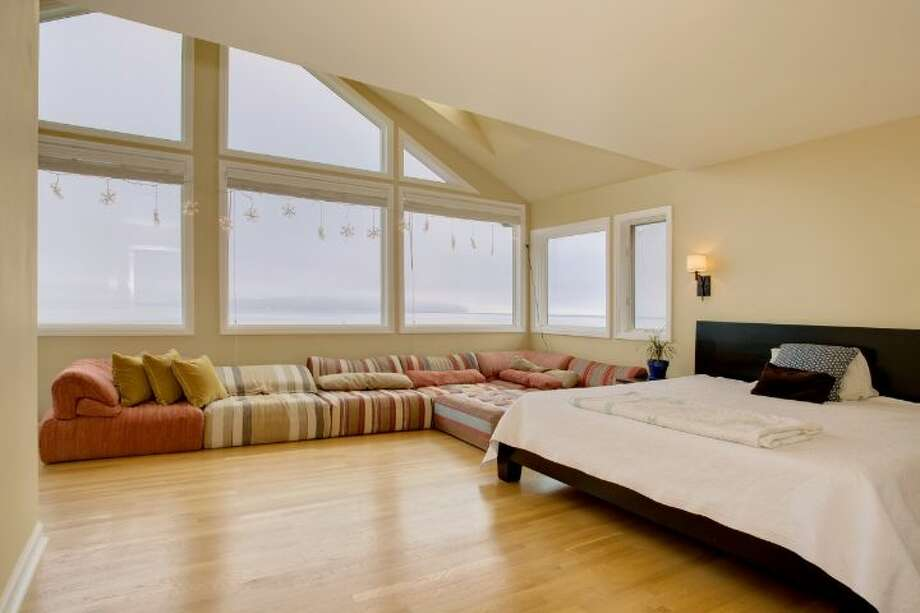 Master bedroom of 327 Lake Washington Boulevard. The 2,560-square-foot  brick house, built in 1928, has four bedrooms and 2.25 bathrooms, a family room, a rec room, exposed wood moldings and doors, a deck, a patio and an outdoor hot tub on a 5,362-square-foot lot. It's listed for $995,000. Photo: Courtesy Kathryn Hinds/Windermere Real Estate