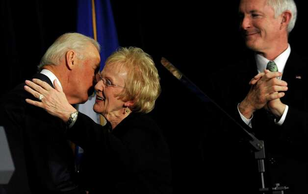 Vice President Joe Biden kisses Newtown First Selectman Pat Llodra after speaking at a conference on gun violence at Western Connecticut State University in Danbury, Conn., Thursday, Feb. 21, 2013. Right is Bridgeport Mayor Bill Finch. Photo: Carol Kaliff / The News-Times