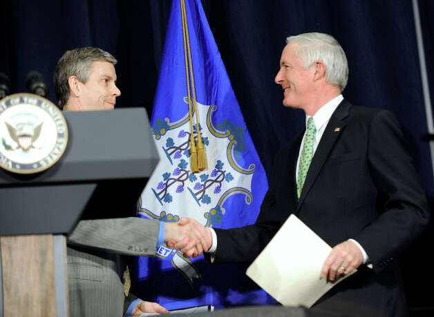U.S. Secretary of Education Arne Duncan, left, shakes hands with Bridgeport Mayor Bill Finch after  speaking at a conference on gun violence at Western Connecticut State University Thursday, Feb. 21, 2013 in Danbury, Conn. Photo: Carol Kaliff / The News-Times
