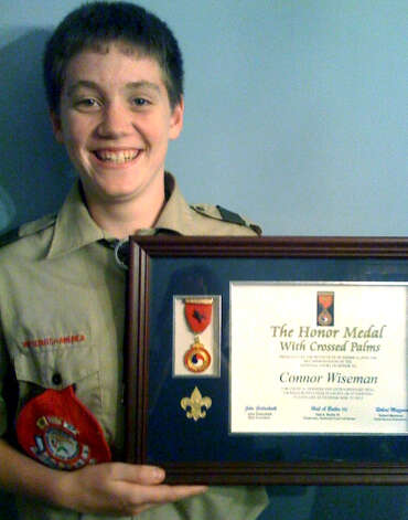 Connor Wiseman, 15, of New Milford is the recipient of the Medal of Honor with Crossed Palms from the Boy Scouts.  Courtesy of the Wisemans  has achieved something few people have: the receipt of the Boy Scouts Medal of Honor with Crossed Palms, the highest Boy Scout award. Connor, who is the first Connecticut Boy Scout to receive such an honor in many years, was recently presented with the award in recognition of, on Feb. 1, 2009 in Vermont, saving a boy he was seated beside on a ski chairlift from falling. Connor was given the medal by State Sen. Andrew Roraback (R-30th) at a local ceremony. He was later invited to the Boy Scoutsí Connecticut Rivers Council dinner during which the presentation was recreated in front of the approximately 300 people in attendance. After learning Connor has an interest in attending the United States Military Academy at West Point after high school, the dinnerís keynote speaker, Rear Admiral Scott Burhoe, president of the Coast Guard Academy and an Eagle Scout, encouraged Connor to check out the Coast Guard Academy. Connor did and subsequently announced he wants to attend the Coast Guard Academy. Since, he and his family attended a private tour of the academy. In addition to the medal of honor, Connor has received a certificate, a citation from the state General Assembly and a proclamation from the governor, all in recognition of saving the boyís life. Connor held the boy who had slipped off the chairlift for several minutes until he gained the attention of the ski patrol, who formed a drop catch, and instructed Connor to let the boy drop 20 to 25 feet into the arms of the ski patrol. No one was injured in the incident. Connor is a member of Troop No. 432.  Courtesy of the Wisemans Photo: Contributed Photo