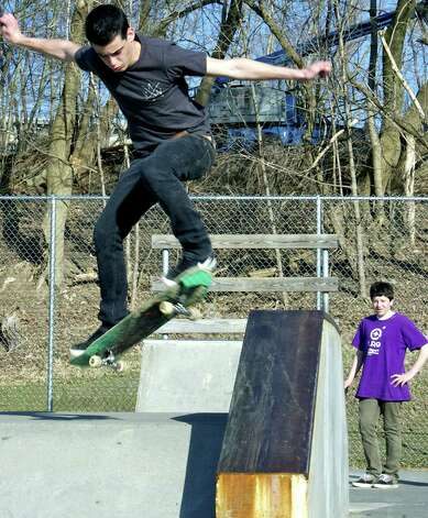 Lucas Mendonca, 17, a senior at New Milford High School, exhibits his talents March 19, 2010 at the Young's Field skateboard park for fellow NMHS student John Silk, 15, a sophomore. Photo: Trish Haldin