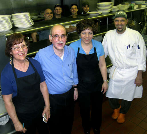 The Windmill Diner restaurant along Routh 7 south (Danbury Road) in New Milford has served customers since 1970 on its present site and since 1967 overall. May 2, 2010. Above are, from left to right, Maria and Angelo Rountos, their daughter, Angela, and their son, Steve, who now manages the restaruant and is the chef. In back are, from left to right? Photo: Norm Cummings