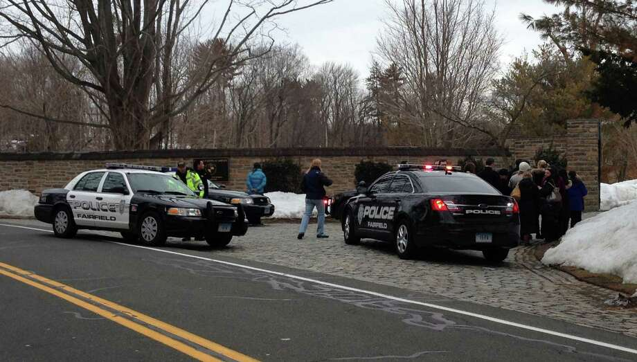 Police from Westport and Fairfield converge on the Beachside Road entrance to Greens Farms Academy on Friday afternoon after a suspected car thief abandoned a car on the property, causing the school to go into lockdown as a precaution.  WESTPORT NEWS, CT 2/22/13 Photo: Paul Schott / Westport News