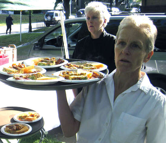 New Milford Social Services director Peg Molina, foreground, and Culinary School director Dawn Hammacott are on hand to make and serve breakfast at the June 11, 2010 Red Cross breakfast on the Village Green in New Milford. Photo: Norm Cummings