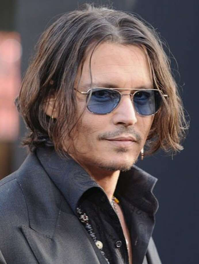 "Johnny Depp, 49He's not the first person you think of when you hear ""action hero,"" but Johnny Depp has certainly carved a niche for himself as Hollywood's (and Tim Burton's) go-to eccentric antihero. Photo: Jon Kopaloff/FilmMagic"