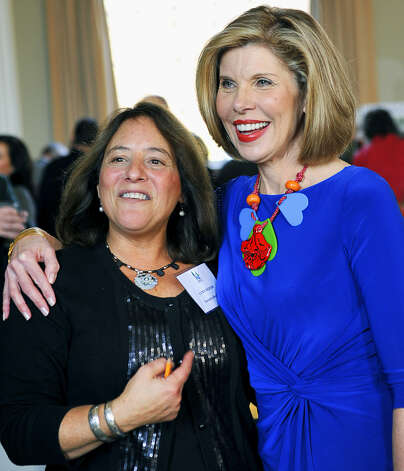 Housatonic Valley Association executive director Lynn Werner, left, and honorary chairman Christine Baranski bond at the Housatonic Valley Association auction, Nov. 21, 2010 at Bryan Memorial Town Hall in Washington.  Photo by Alyson Hickey Photo: Alyson Hickey
