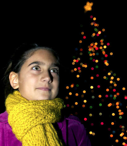 Yasmine Bazos of Bridgewater stands near her town's Christmas tree, which is topped by a star for the first time this year thanks to her urging and the craftsmanship of New Milford resident Sandy Petersen. Dec. 3, 2010 Photo: Trish Haldin