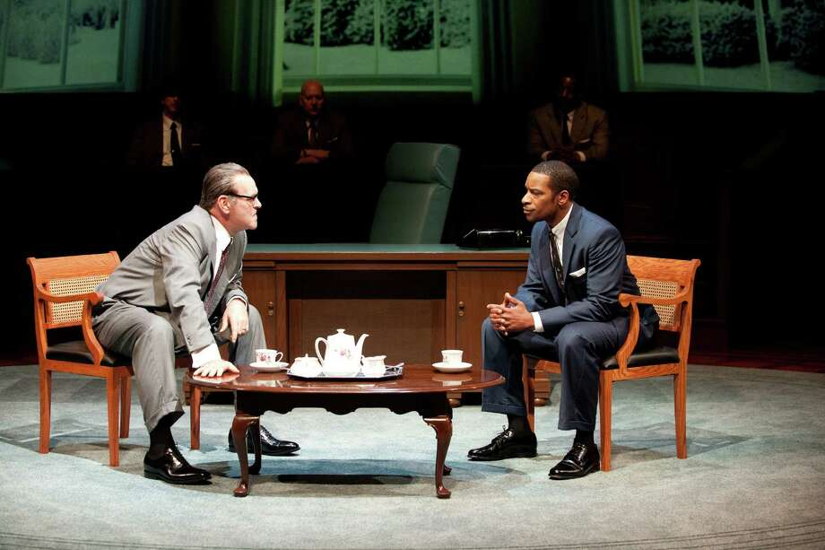 "This theater image released by Columbia University shows Jack Willis as Lyndon Johnson, left, and Kenajuan Bentley as the Rev. Martin Luther King Jr. in a scene from ""All The Way"" by Robert Schenkkan. Schenkkan's ""All the Way"" have been named the inaugural winners of a theater award honoring the late Sen. Edward Kennedy. Columbia University on Friday said both playwrights will get the award as well as $100,000 each, one of the largest prizes given for dramatic writing. (AP Photo/Columbia University, Jenny Graham) Photo: Jenny Graham"