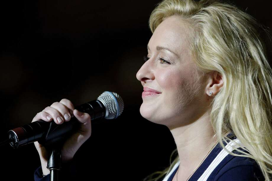 FILE - This Nov. 14, 2008 file photo shows country singer Mindy McCready performsing in Nashville, Tenn. McCready's family has planned a private funeral service to be held Tuesday, Feb. 26, 2013 in Fort Myers, Fla. McCready, who hit the top of the country charts before personal problems sidetracked her career, died Sunday, Feb. 17. She was 37. (AP Photo/Mark Humphrey, File) Photo: Mark Humphrey