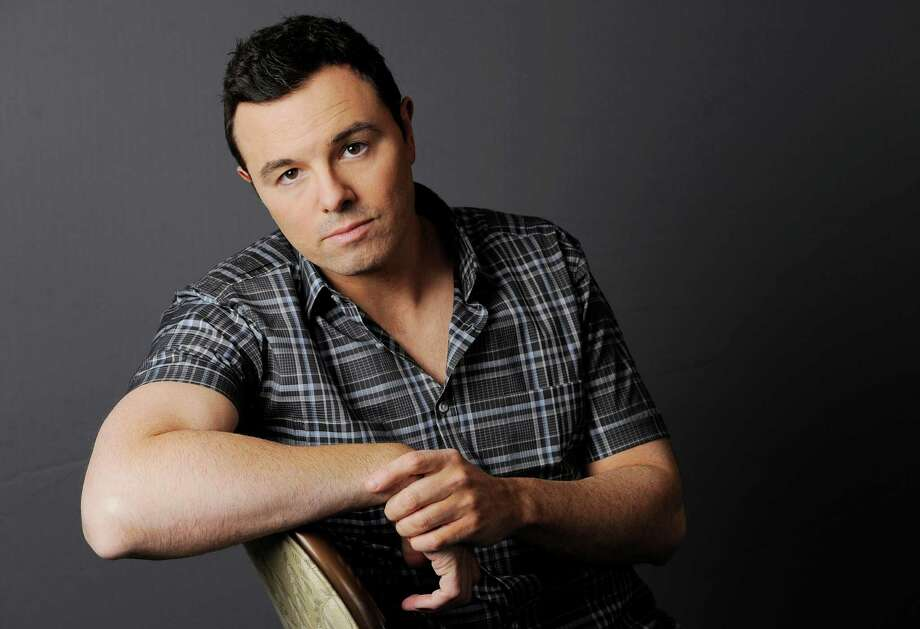 FILE - This June 16, 2012 photo shows Seth MacFarlane posing for a portrait at The Four Seasons Hotel in Beverly Hills, Calif.  Early reviews for Seth MacFarlane's Oscar-hosting skills are very positive. The Academy Awards won't be presented until Sunday, Feb. 24, 2013, but MacFarlane won laughs from the show's director during a rehearsal Thursday, Feb. 21,  inside the Dolby Theatre. (Photo by Chris Pizzello/Invision/AP) Photo: Chris Pizzello