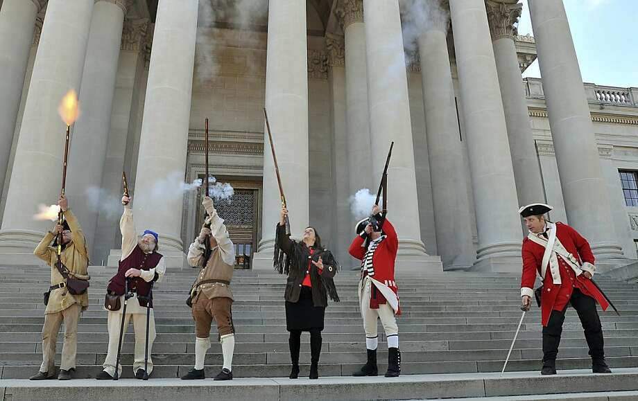 White House drone at 12 o'clock! Re-enactors and West Virginia Secretary of State Natalie Tennant (center) fire muskets outside the Capitol building in Charleston to celebrate History Day. Photo: Craig Cunningham, Associated Press