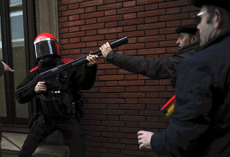Not the smartest way to confront a riot cop: Spaniards protest government austerity measures