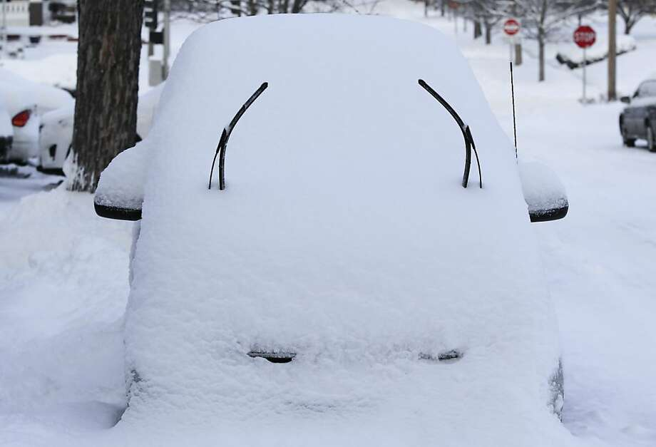 Raised wipers and a snow-covered hood give a car a quizzical expression in Omaha, Neb. Photo: Nati Harnik, Associated Press