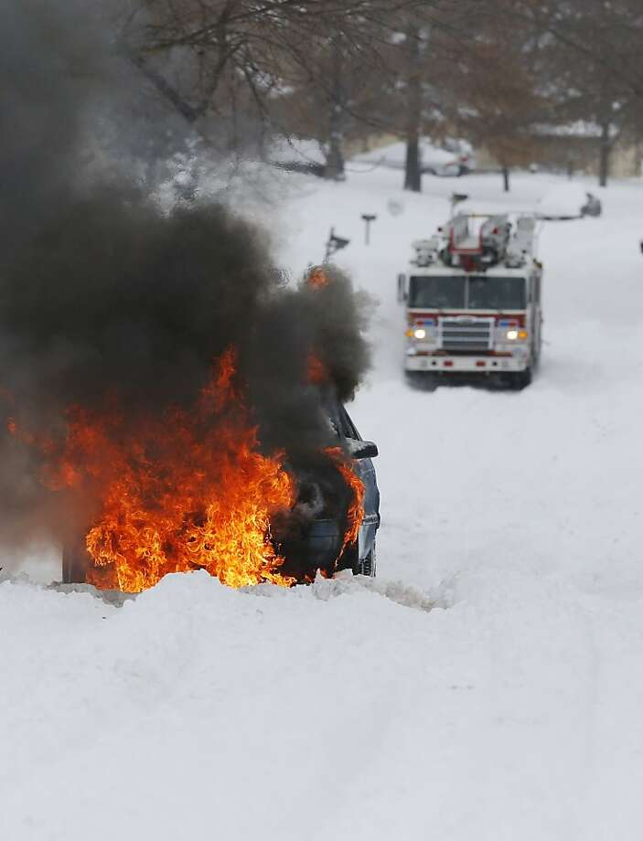 Bad - your car gets stuckin the snow while going up a hill. Worse - your car bursts into flames after getting stuck in the snow while going up a hill. That's what happened here in Lawrence, Kan. Photo: Orlin Wagner, Associated Press