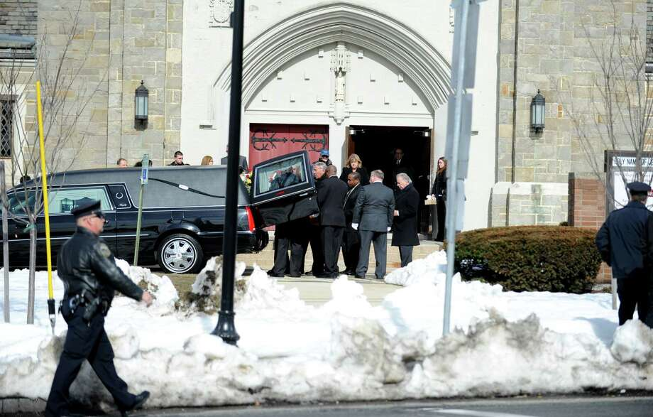 Funeral services for Kevin and Brenda Tanski, of Milford, who were hit by a car on Feb. 11, 2013 in Milford, Conn. while walking along Bridgeport Avenue, are held Friday Feb. 22, 2013 at the Holy Name of Jesus Roman Catholic Church, in Stratford, Conn. Photo: Autumn Driscoll / Connecticut Post