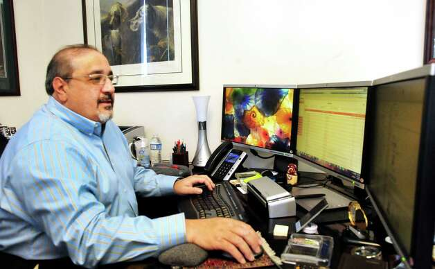 Frank Ballatore works in his office at his business, The New England Computer Group, Inc., in Danbury, Conn. Thursday, Feb. 21, 2013. Photo: Michael Duffy / The News-Times