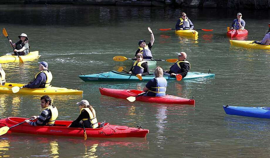 Kayakers were among the first to paddle into the 750-foot channel that eventually will link Lake Merritt to the estuary, S.F. Bay. Photo: Michael Macor, The Chronicle