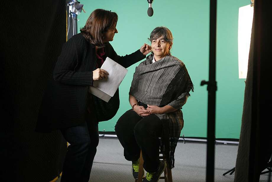 Director Dawn Logsdon (l-r) with Albertina Zarazua Padilla's face at the SF Main library in San Francisco, Calif. Photo: Liz Hafalia, The Chronicle