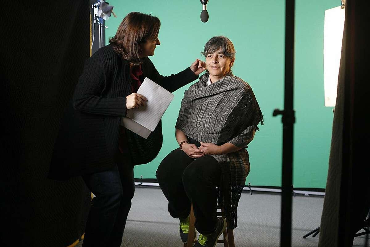 Director Dawn Logsdon (l-r) with Albertina Zarazua Padilla's face at the SF Main library in San Francisco, Calif.
