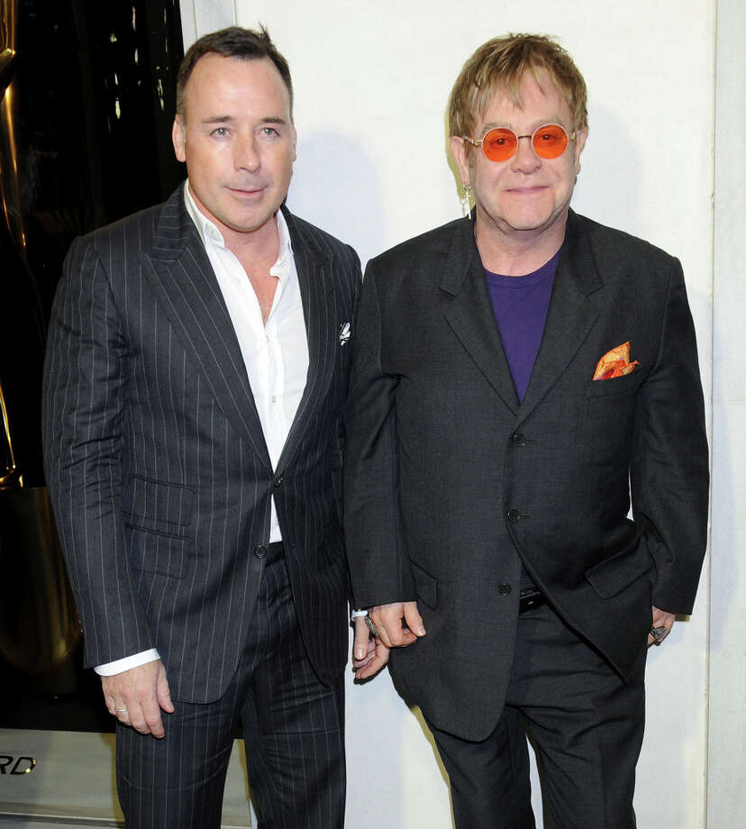 Musician Sir Elton John (R) and David Furnish arrive at the Tom Ford cocktail party. Photo: Gregg DeGuire, WireImage / 2013 Gregg DeGuire