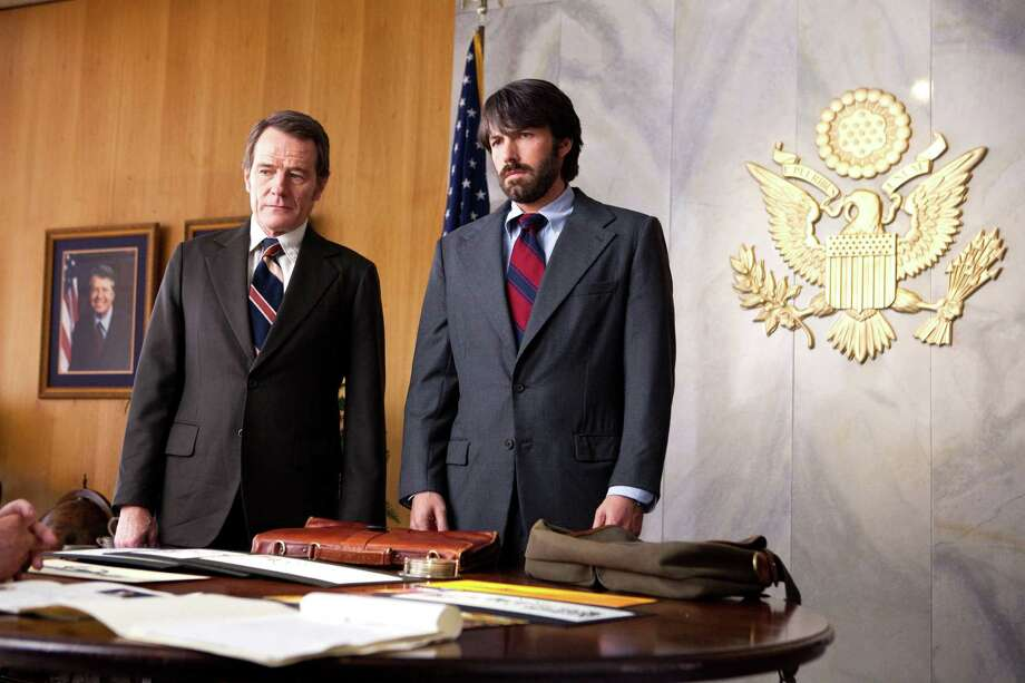 "This film image released by Warner Bros. shows Bryan Cranston, left, as Jack O'Donnell and Ben Affleck as Tony Mendez in ""Argo,""  a rescue thriller about the 1979 Iranian hostage crisis - and our movie reviewer's choice to take home the Best Picture Oscar on Sunday, Feb. 24. Photo: AP Photo/Warner Bros., Associated Press / Warner Bros."