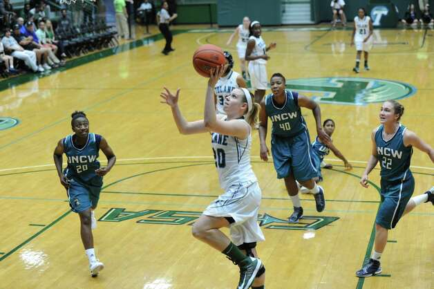 Guard Danielle Blagg, a Tulane sophomore from Smithson Valley, drives to the basket in a win over North Carolina-Wilmington on Dec. 2, 2012. Blagg leads Tulane at 39.4 percent (50 of 127) on 3-pointers and she's second at 10.2 points per game. Photo: Tulane Athletics, Courtesy Photo