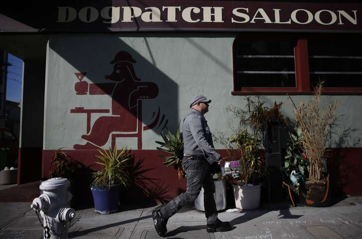 James Ellis of San Francisco walks past the Dogpatch Saloon on his way to work in the Dogpatch neighborhood on Friday, February 22, 2013 in San Francisco, Calif.