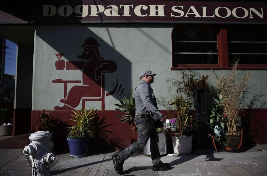 James Ellis of San Francisco walks past the Dogpatch Saloon on his way to work in the Dogpatch neighborhood on Friday, February 22, 2013 in San Francisco, Calif. Photo: Lea Suzuki, The Chronicle