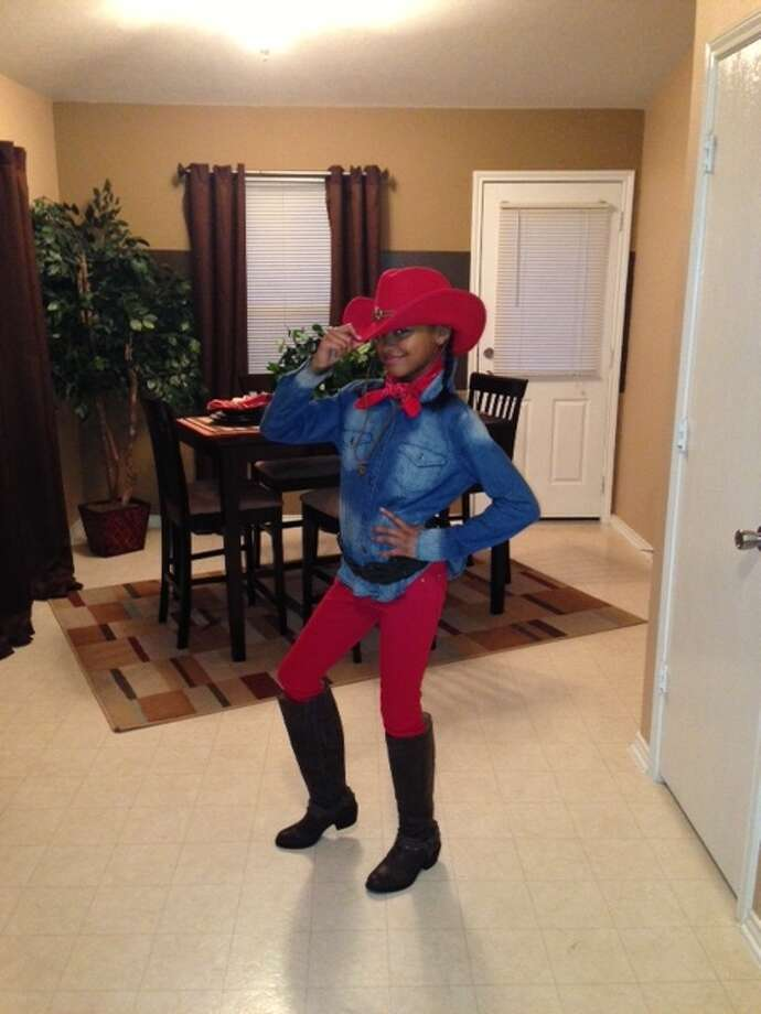 These are Chron.com readers' Go Texan Day submissions from 2013. Enter your best rodeo-themed photo using the form below and you could win a $500 Cavender's gift card.This photo: Myca's red rodeo outfit. Photo: Reader Submission