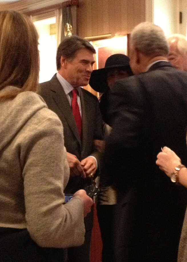 Rick Perry greets attendees at a Texas State Society breakfast. Photo: Picasa