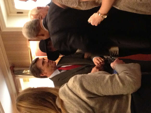 Rick Perry greets attendees at a Texas State Society breakfast.