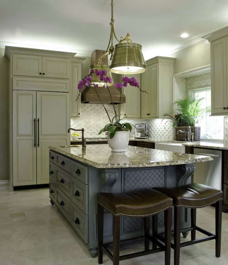 Layering lighting in the kitchen makes the space more appealing and more functional. Photo: Photos Courtesy Bradshaw Designs