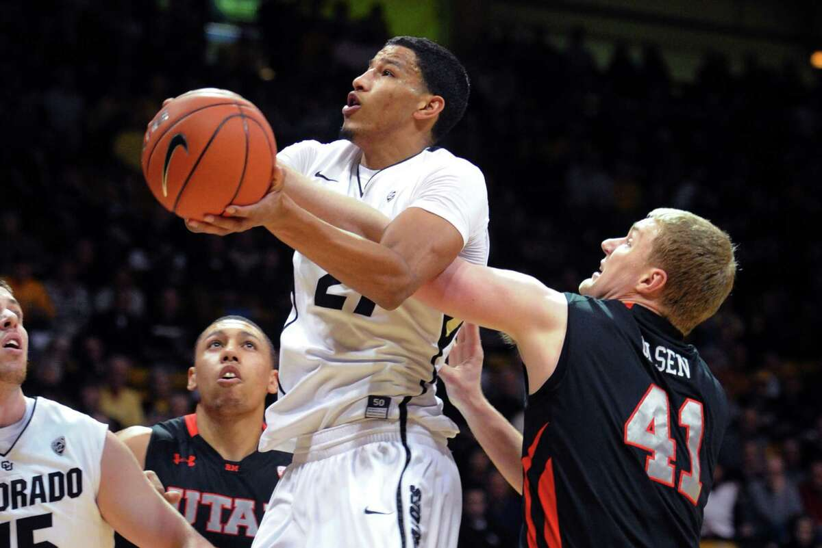 Colorado's Andre Roberson, left, drives to the basket past Utah's Jeremy Olson during the first half of their NCAA college basketball game, Thursday, Feb. 21, 2013, in Boulder, Colo. (AP Photo/The Daily Camera, Cliff Grassmick) NO SALES; MAGS OUT; TV OUT