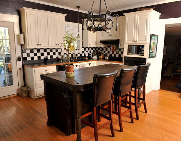 In the kitchen, the island was crafted from part of an old piano.