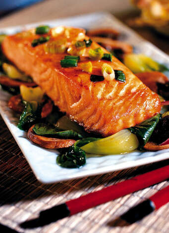 Ginger salmon filets carry healthful omega-3 fats. Salmon and other seafood are a good source of omega-3 fats. Photo: James F. Quinn / Chicago Tribune